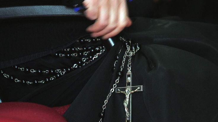 A detail of a priest's crucifix