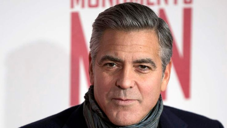 "Actor and director George Clooney arrives for the UK premiere of his film ""The Monuments Men"" in London"