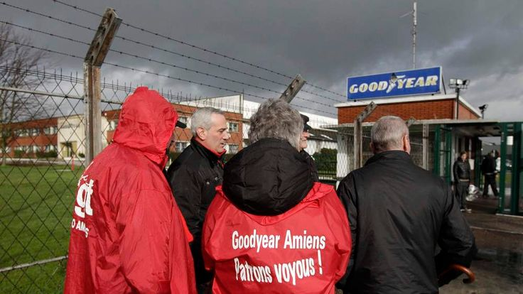 Labour union members stand at the entrance of the Goodyear tyres factory in Amiens, northern France