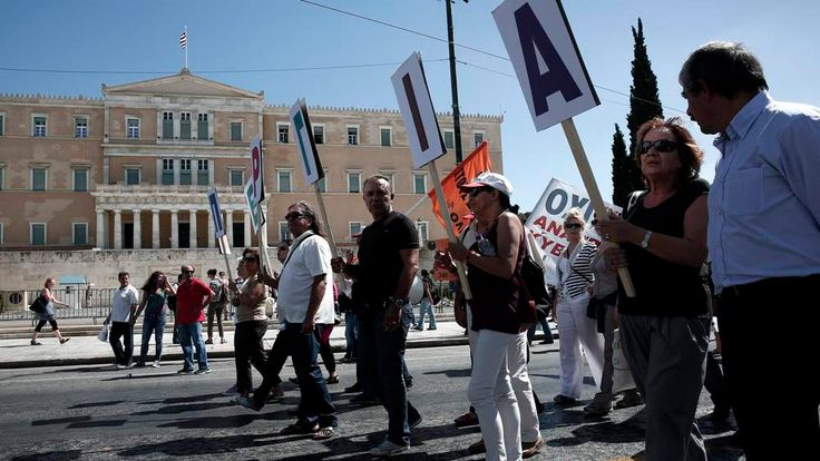 Protesters march in front of the parliament during an anti-government  rally in Athens