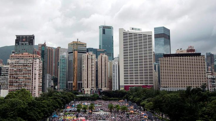 Thousands of pro-democracy protesters gather to march in the streets to demand universal suffrage in Hong Kong