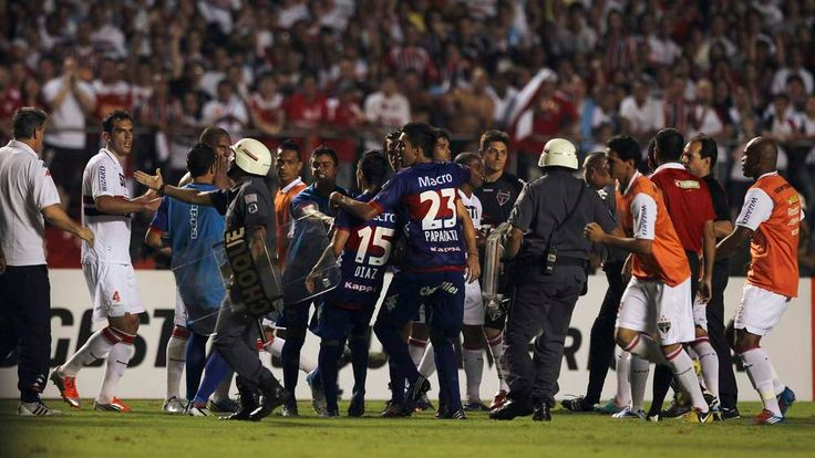 Players of Sao Paulo argue with Tigre players after first half of Copa Sudamericana soccer match