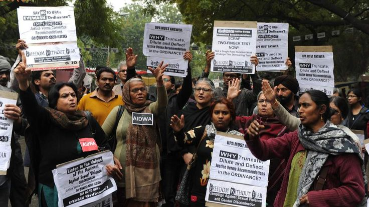 Indian activists shout slogans during a protest for the implementation  of harsher punishments and quicker trials for rape cases in New Delhi