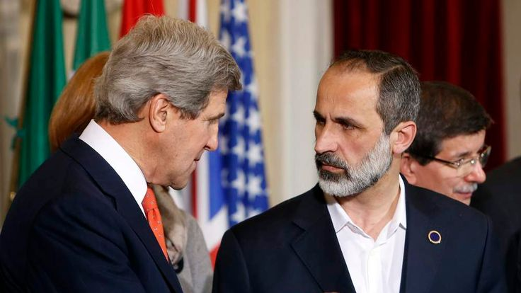 US Secretary of State John Kerry talks with New Syrian National Coalition head Mouaz al-Khatib during a meeting at Villa Madama in Rome