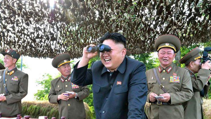KCNA handout shows North Korean leader Kim Jong Un looking through a pair of binoculars during inspection of Hwa Islet Defence Detachment off east coast of Korean peninsula