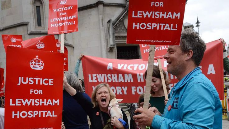 Demonstrators outside the High Court in London celebrate