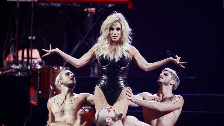 Singer Ke$ha performs with dancers during the iHeartRadio Music Festival in Las Vegas