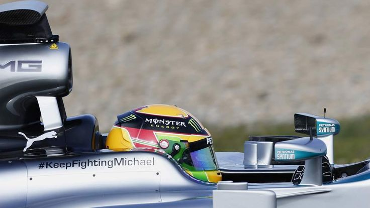 Mercedes Formula One racing driver Lewis Hamilton drives with message of support for Michael Schumacher