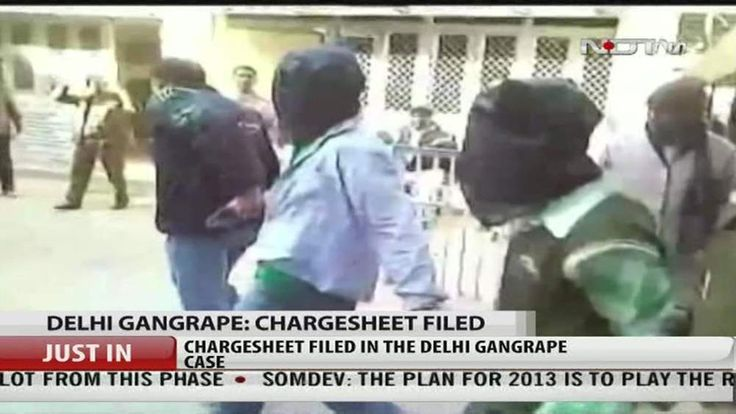 Two of the men accused of raping and murdering a medical student are led out of court in Delhi