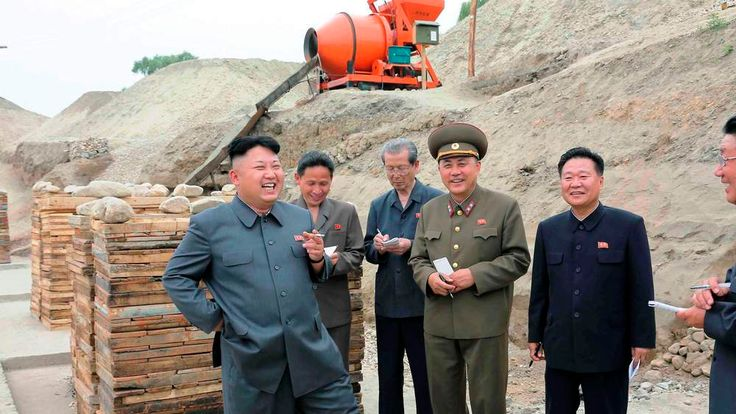 North Korean leader Kim Jong Un smokes a cigarette as he gives guidance on the development of Ssuk Islet