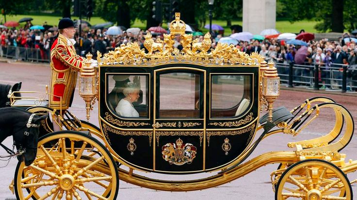 The new carriage carrying Queen Elizabeth II and The Duke of Edinburgh leaves Buckingham Palace, London, ahead of the State Opening of Parliament.