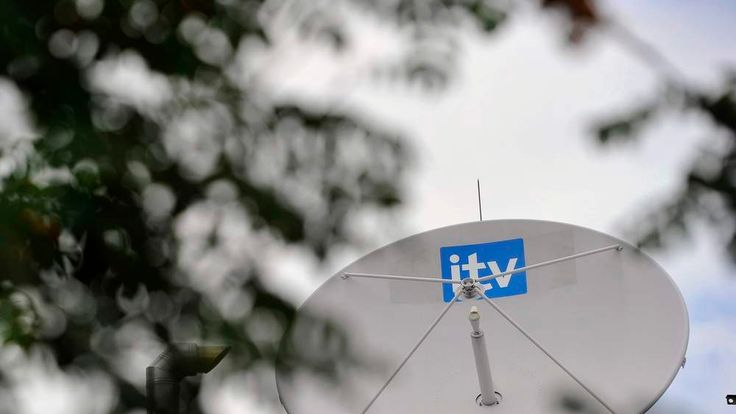 A satellite dish is seen on the roof of ITV television studios in London