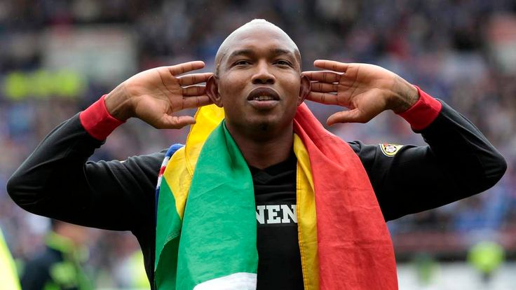 Rangers' Diouf gestures to their fans while celebrating after winning the Scottish Premier League after their soccer match victory against Kilmarnock in Scotland