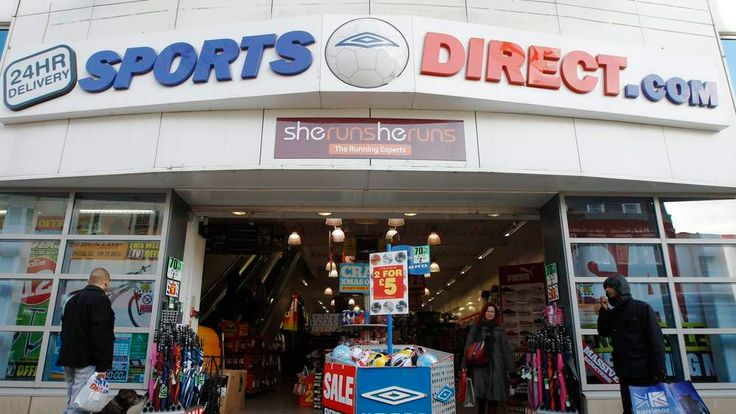 Shoppers wait outside a branch of Sports Direct in Brighton southern England