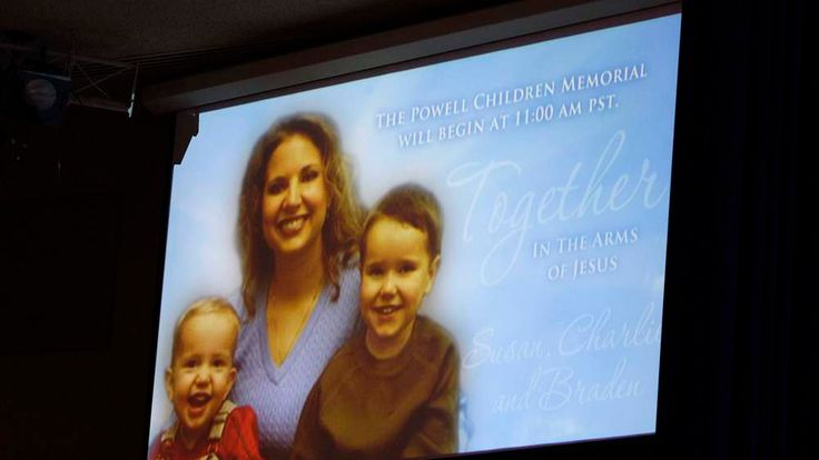 A picture of Susan Powell is seen on a screen with her children during funeral services in Tacoma