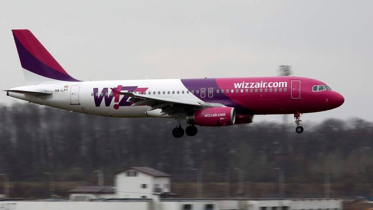 A Wizz Air Airlines Airbus A320 plane lands at Henri Coanda Airport in Otopeni, near Bucharest