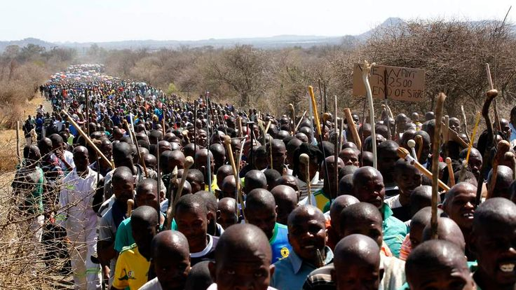 Mine workers take part in a march at Lonmin's Marikana mine in South Africa's North West Province September 10, 2012.
