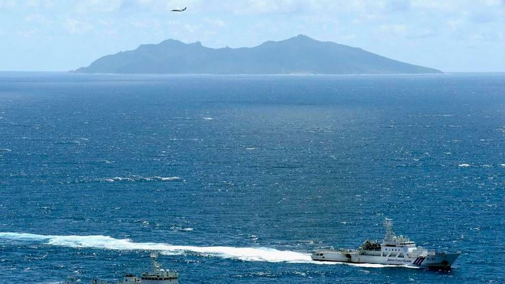 An aerial photo shows the Chinese marine surveillance ship Haijian No. 51 cruising as the Japan Coast Guard ship Ishigaki sails near the disputed islands, called Senkaku in Japan and Diaoyu in China, in the East China Sea.