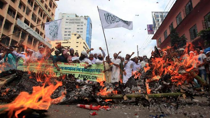 Bangladeshi Muslims shout slogans after burning a mock coffin of U.S President Barack Obama during a protest in front of the National Mosque in Dhaka