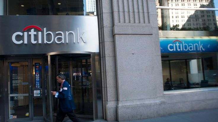 Passersby walk in front of a Citibank branch in New York