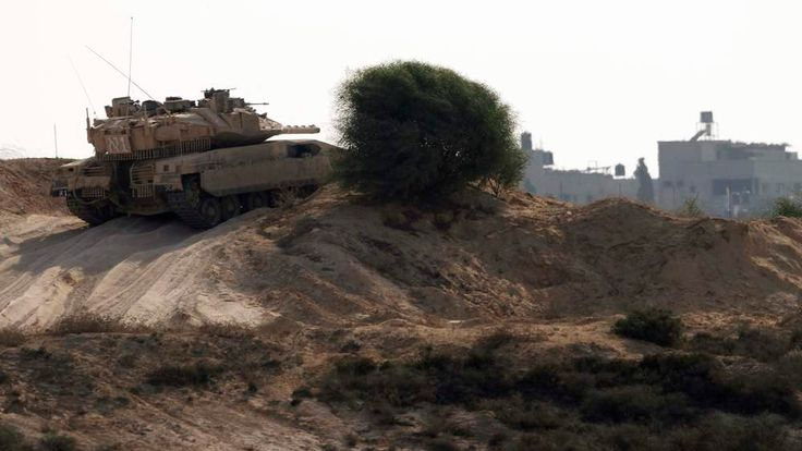 An Israeli tank patrols just outside the border with the northern Gaza Strip
