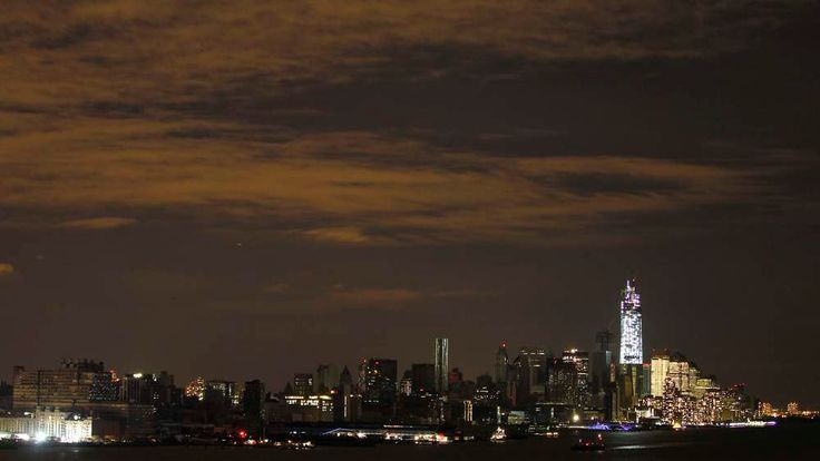 A general view of New York's Lower Manhattan with parts of it remaining in the dark and the lit-up One World Trade Center as seen from Weehawken, New Jersey, November 1, 2012.