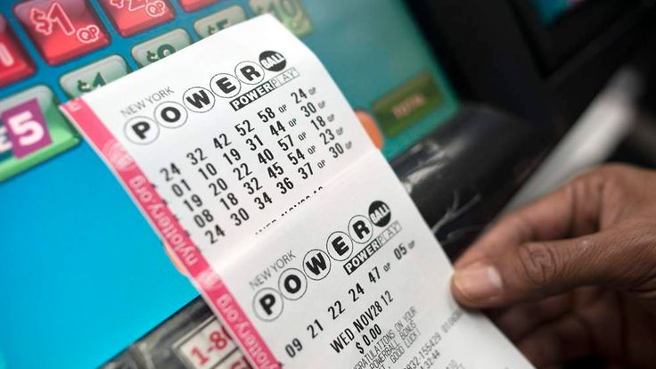 Powerball lottery tickets are taken out of a machine in New York