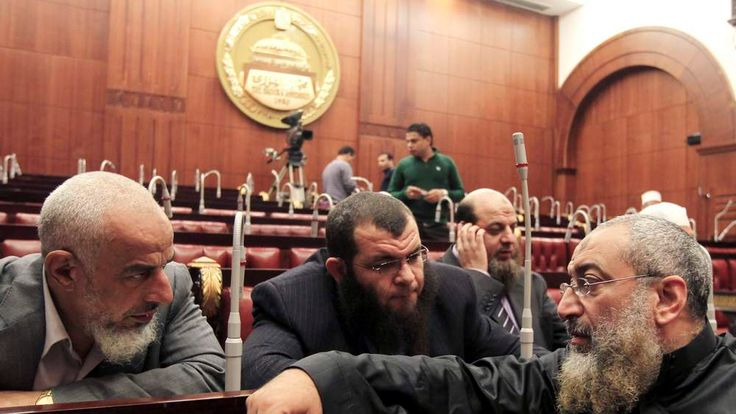 Members of Egypt's constituent assembly discuss during the last voting session on a new draft constitution at the Shoura Assembly in Cairo