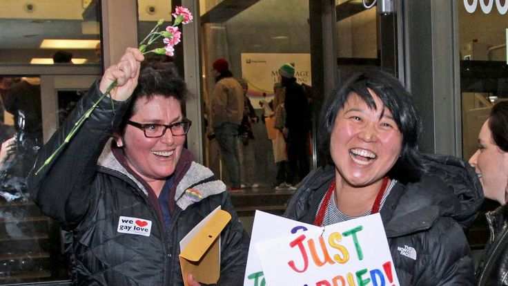 Junia Ribeiro and Patty Oh celebrate after getting their marriage license in Seattle