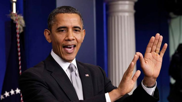 """U.S. President Obama gestures as he speaks to the media about the """"fiscal cliff"""" in Washington"""