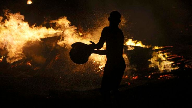 A man trying to extinguish the fire