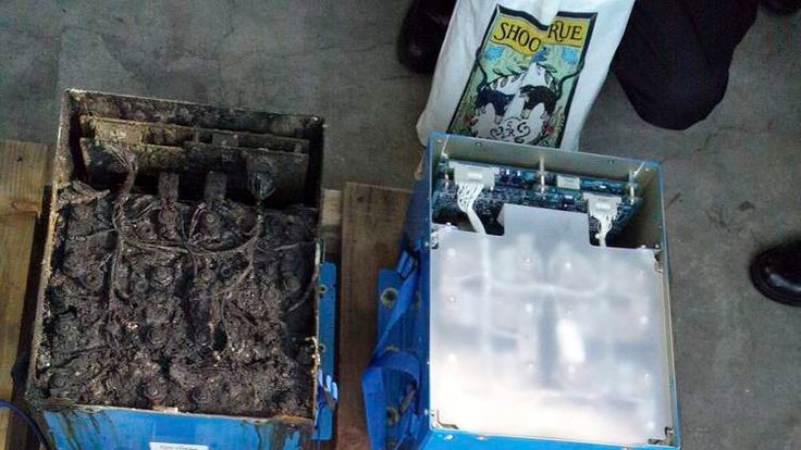 The burnt auxiliary power unit battery, removed from an ANA Boeing Co 787 Dreamliner plane which made an emergency landing, is seen next to an undamaged one