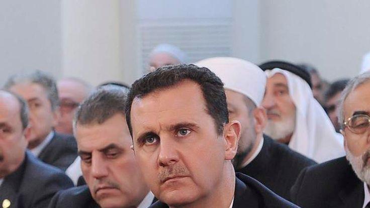 Syria's President Bashar al Assad attends prayers during celebrations of Prophet Mohammed's Birthday