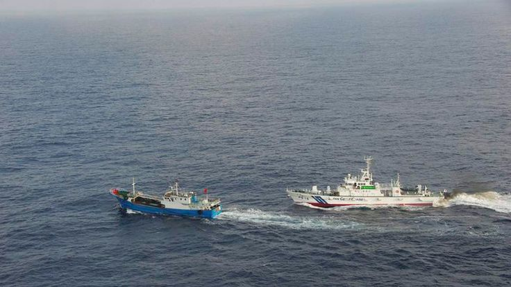 A Chinese fishing boat  is pursued by a Japan Coast Guard vessel in waters northeast of Miyako Island