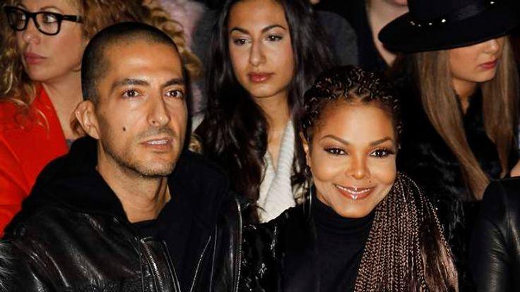 U.S. singer Jackson and her boyfriend Al Mana attend  the Roberto Cavalli Autumn/Winter 2013 collection at Milan Fashion Week F