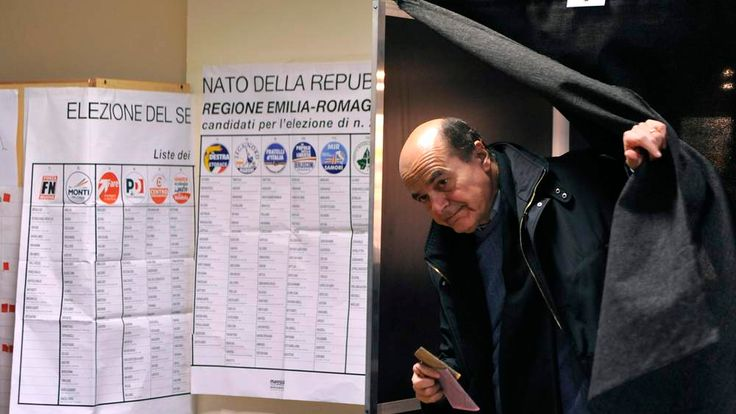 Democratic party leader Pier Luigi Bersani leaves a polling booth after casting his vote at a polling station in Piacenza