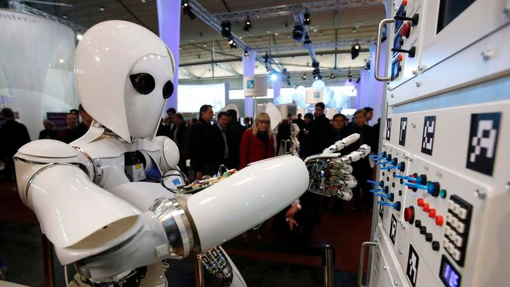 The humanoid robot AILA (artificial intelligence lightweight android) operates a switchboard during a demonstration by the German research centre for artificial intelligence at the CeBit computer fair in Hanover