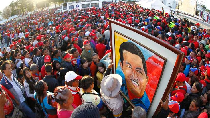Supporters of Venezuela's late President Chavez wait for a chance to view his body at the military academy in Caracas