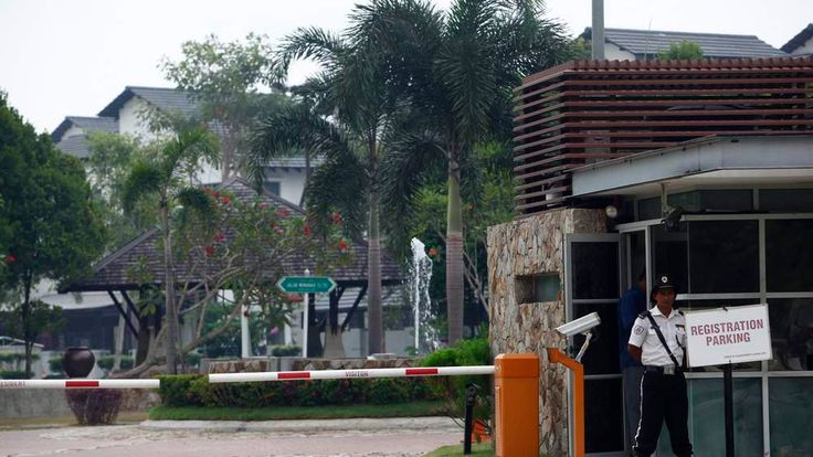 A security guard stands at the entrance of a compound where the house of pilot Zaharie Ahmad Shah is located in Shah Alam, near Kuala Lumpur