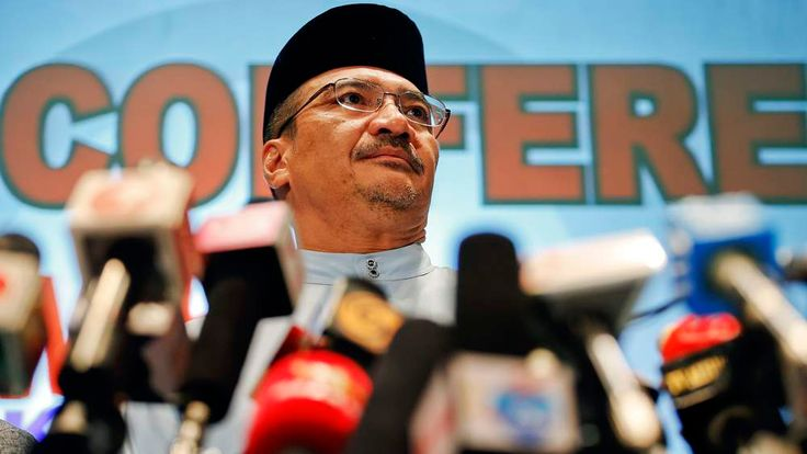 Malaysian Transport Minister Hishammuddin Hussein listens to reporter's questions about the missing Malaysia Airlines flight MH370, at Kuala Lumpur International Airport