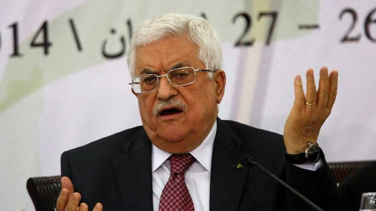 Palestinian President Abbas gestures as he address the Palestinian Liberation Organization's central council in the West Bank City of Ramallah