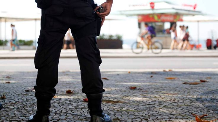 A policeman patrols near Copacabana beach in Rio de Janeiro
