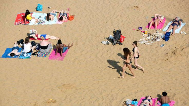 Sunbathers sit on the beach in Broadstairs