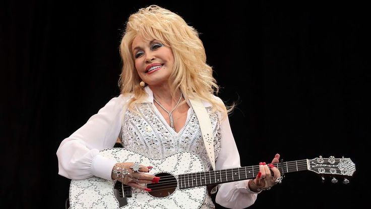 Parton performs on the Pyramid Stage at Worthy Farm in Somerset, during the Glastonbury Festival