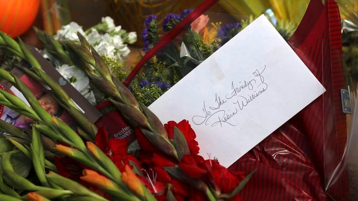 A card and flowers are seen outside the home of actor Robin Williams in Tiburon, California