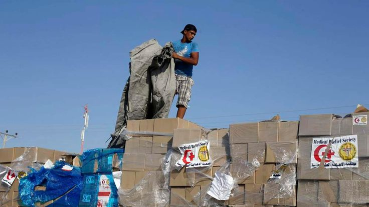 Palestinian man checks a truck loaded with medical aid after entering Gaza at the Kerem Shalom crossing, in Rafah in the southern Gaza Strip