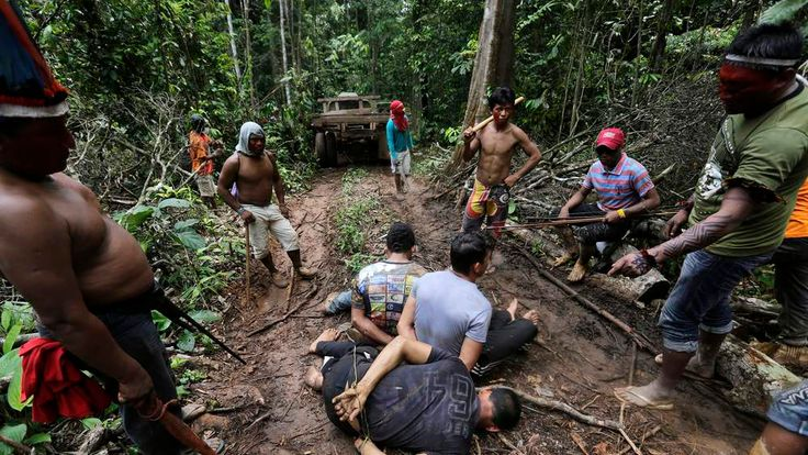 Ka'apor Indian warriors tie up loggers during a jungle expedition in the Alto Turiacu Indian territory