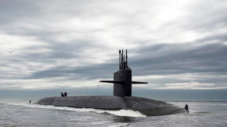 The Ohio-class ballistic missile submarine USS Tennessee returns to Naval Submarine Base Kings Bay, Georgia in this handout photo