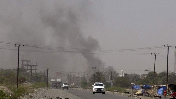 Smoke rises from a government building in al-Houta, the provincial capital of Yemen's southern Lahej province