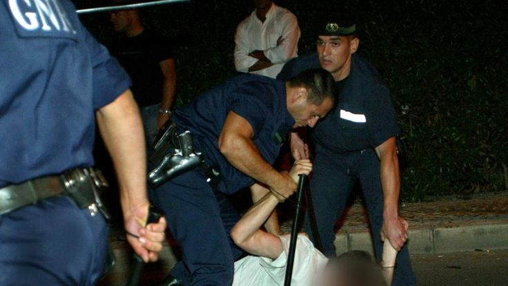 PORTUGUESE POLICE RESTRAINT AN ENGLAND SOCCER FAN IN ALBUFEIRA.